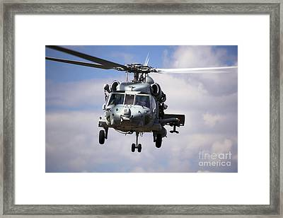 Navy Pilots In A Sh-60f Seahawk Conduct Framed Print by Michael Wood