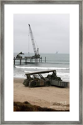 Navy Seabees Dismantling An Elevated Framed Print by Michael Wood
