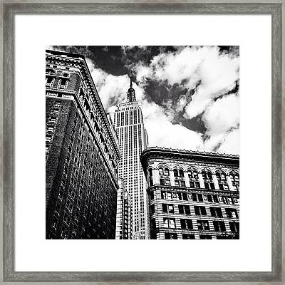 New York City - Empire State Building And Clouds Framed Print