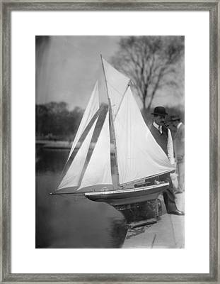 New York City, Man With Toy Yacht Framed Print