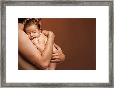 Newborn Baby Sleeping On The Shoulder Of His Father The Over Brown Background Framed Print by Pavlo Kolotenko