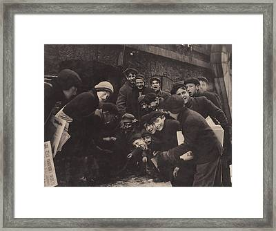 Newsboys Playing A Dice Game Framed Print by Everett