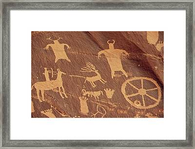 Newspaper Rock Is A Large Cliff Mural Framed Print by Everett
