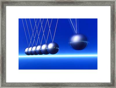 Newton's Cradle In Motion Framed Print by Pasieka