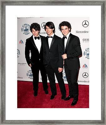 Nick Jonas, Joe Jonas, Kevin Jonas Framed Print