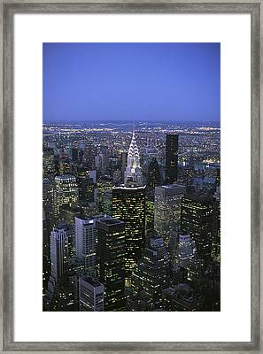 Night View Of The Manhattan Skyline Framed Print by Todd Gipstein