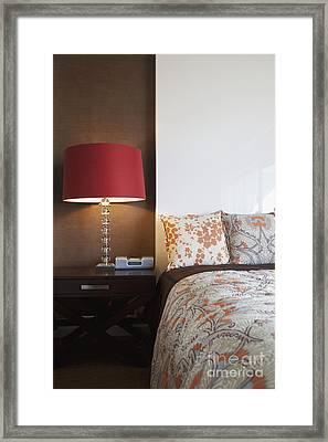 Nightstand And Lamp Next To A Bed Framed Print by Inti St. Clair