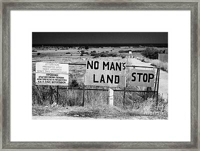 no mans land and restricted area of the UN buffer zone in the green line dividing cyprus Framed Print by Joe Fox