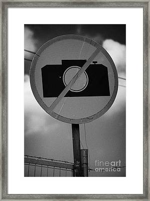 no photography sign at the greek cypriot army border post at the UN buffer zone cyprus green line Framed Print by Joe Fox