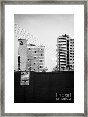 No Photography Warning Signs At Varosha Forbidden Zone With Salaminia Tower Hotel Abandoned In 1974 Framed Print by Joe Fox