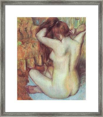 Nude Woman Combing Her Hair Framed Print by Edgar Degas