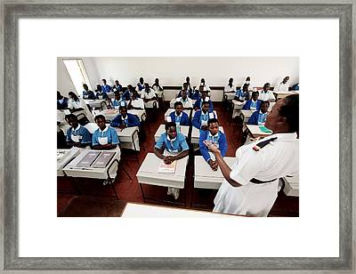 Nurse Training Framed Print by Mauro Fermariello