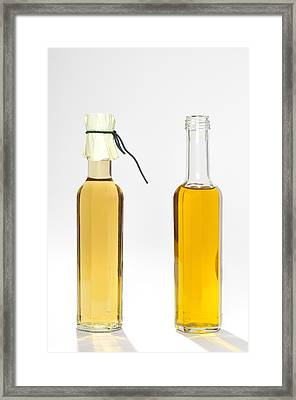 Oil And Vinegar Bottles Framed Print by Matthias Hauser