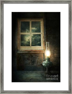 Oil Lamp On Table By Window Framed Print