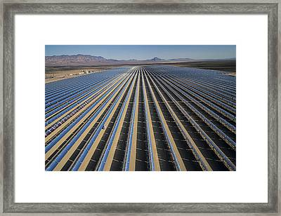 Oil Piped Down Long Rows Of Reflectors Framed Print by Michael Melford