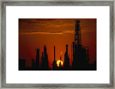 Oil Refinery Silhouetted Framed Print by Paul Chesley