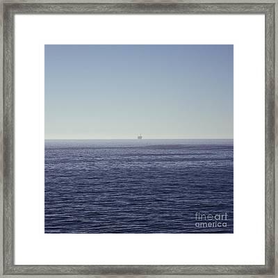 Oil Rig On Ocean Framed Print by Eddy Joaquim