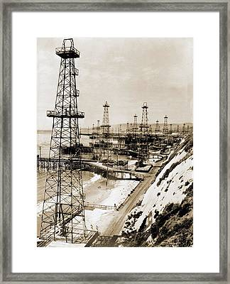 Oil Well Derricks On The Beach Framed Print by Everett
