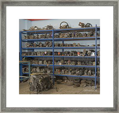 Old Automobile Parts On Shelves Framed Print by Noam Armonn
