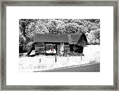 Framed Print featuring the photograph Old Barns With Red Gate by Susan Leggett