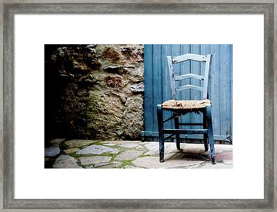 Old Blue Wooden Caned Seat Chair At Doorstep Framed Print by Alexandre Fundone