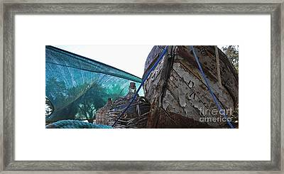 Framed Print featuring the photograph Old Boat And Flagons by Andy Prendy