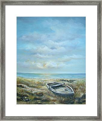 Old Boat Beached Framed Print