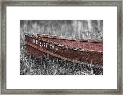 Old Boat Washed Ashore  Framed Print by Joe Gee