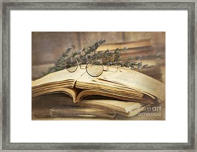Old Books Open On Wooden Table  Framed Print