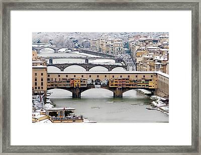 Old Bridge Under Snow Framed Print by Guido Agapito