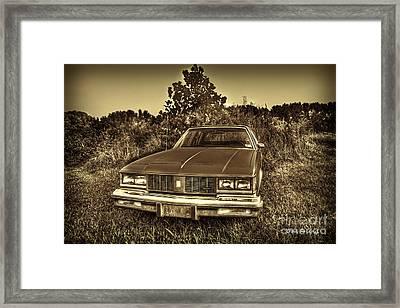 Old Car In Field Framed Print by Dan Friend