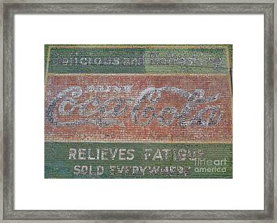 Framed Print featuring the photograph Old Coca Cola Painted Brick Wall by Doris Blessington