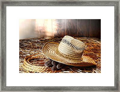 Old Farmer Hat In Hay Barn Framed Print by Olivier Le Queinec