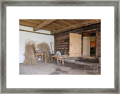 Old Fashioned Cabin Front With A Sharpening Stone Framed Print by Jaak Nilson