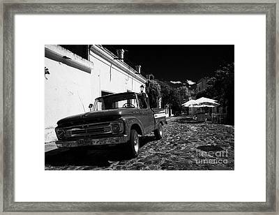 old ford pickup truck on historic paved spanish street Barrio Historico Colonia Del Sacramento Framed Print by Joe Fox