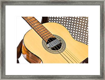 Framed Print featuring the photograph Old Guitar In A Chair by Susan Leggett