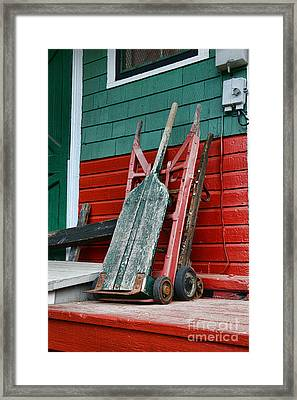 Old Hand Trucks Framed Print by Paul Ward