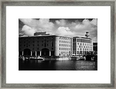 Old Historic Warehouse And The New Hilton Hotel At The Albert Dock Liverpool Merseyside England Uk Framed Print by Joe Fox