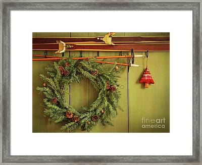 Old Pair Of Skis Hanging With Wreath  Framed Print by Sandra Cunningham