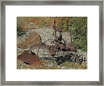 Old Plow Framed Print by Ernie Echols