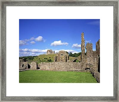 Old Ruins Of An Abbey With A Castle In Framed Print