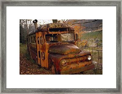 Old Rusting School Bus Sitting Among Framed Print by Raymond Gehman