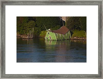 Old Shack Sinking  Framed Print by Roger Lewis