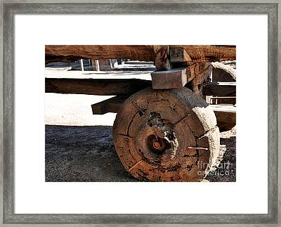 Old Timber Wheel Framed Print by Kaye Menner