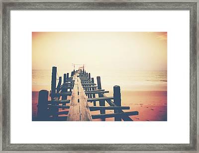 Old Wood Bridge To The Sea Framed Print by Wanchai Yoosumran