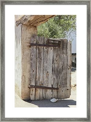 Old Wooden Cemetery Gate In The Adobe Framed Print by Douglas Orton