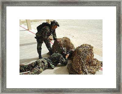 Oldier Fills In A Defensive Lining Framed Print
