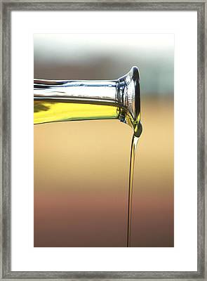 Olive Oil Being Poured Framed Print by Frances Andrijich