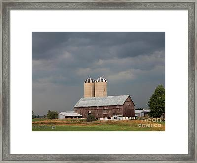 Ominous Clouds Over The Barn Framed Print by J McCombie
