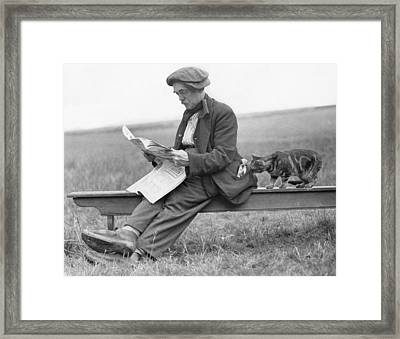 On Bench With Cat Framed Print by Hulton Collection